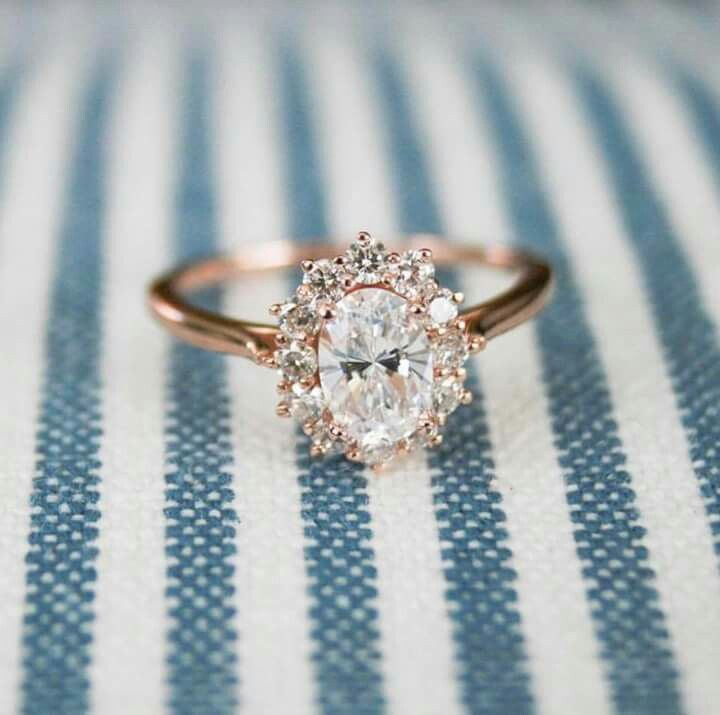 A pretty halo set diamond engagement ring with a rose gold setting