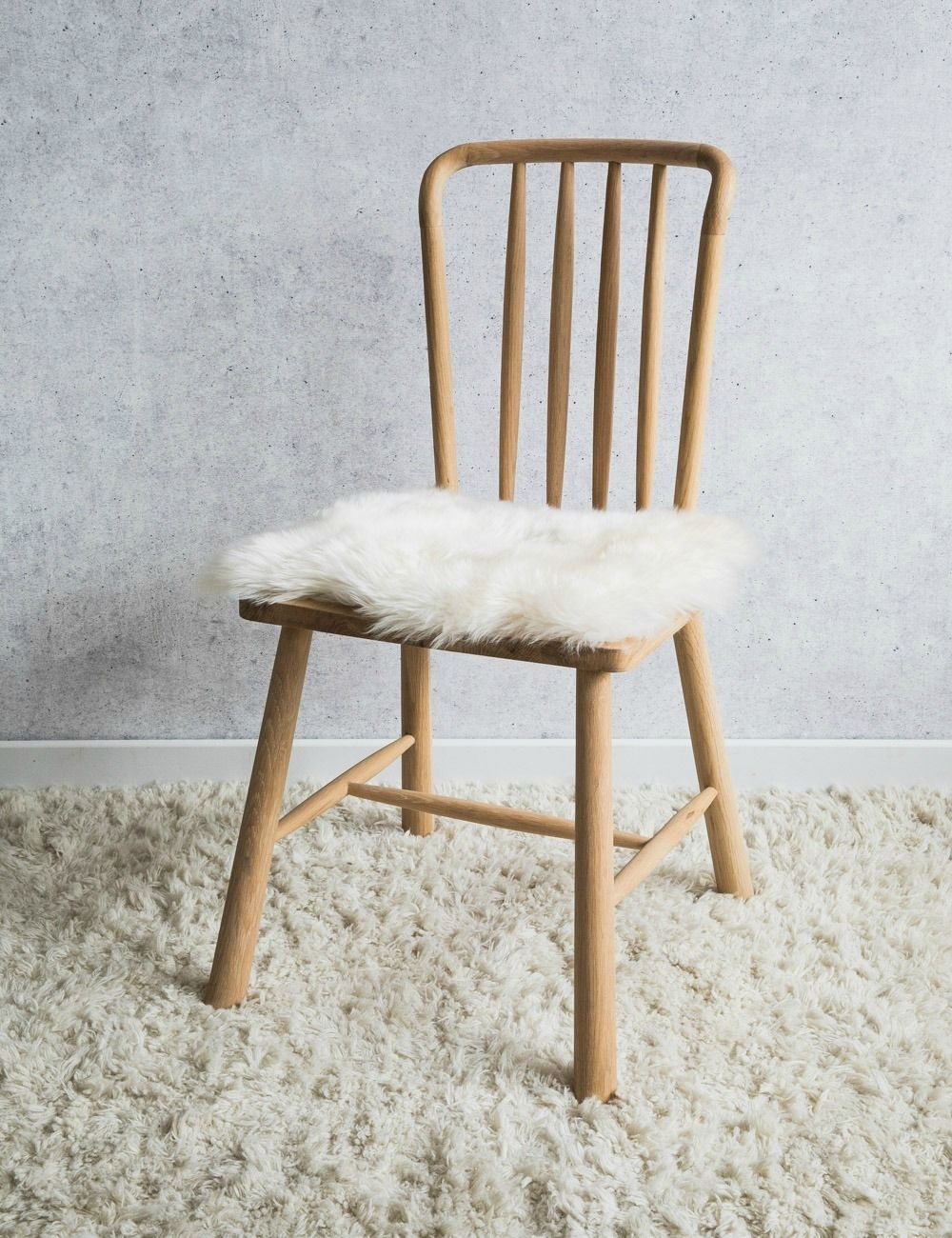 W: 42cm x L: 50cm Sheepskin is dirt repellent - try shaking and airing to clean. Do not machine wash.   If you need to further clean, use lukewarm water and a mild detergent.   Never dry by a radiator.  Restore shine by brushing with a soft brush.