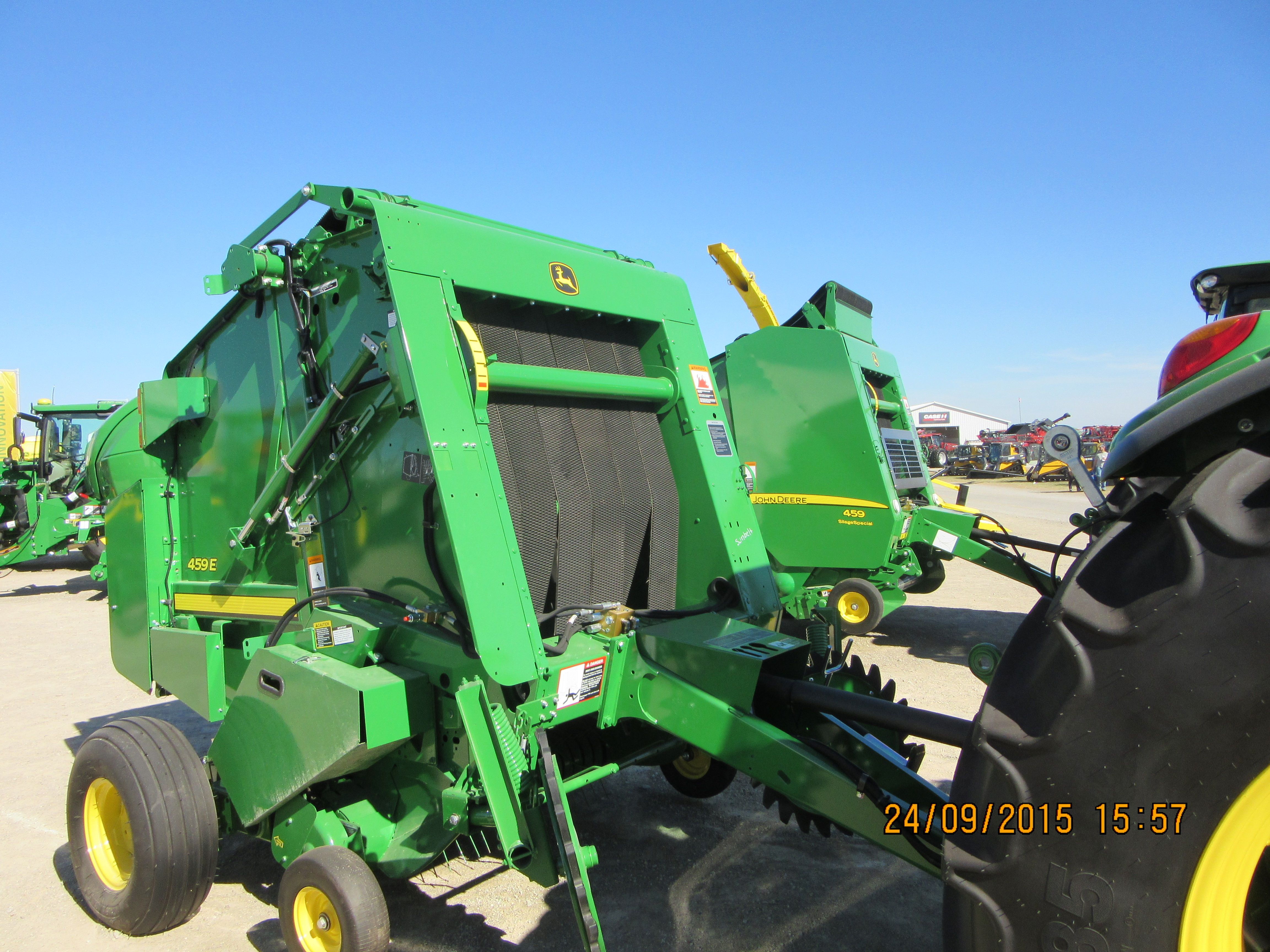 New John Deere 459E round baler with another 459 in background