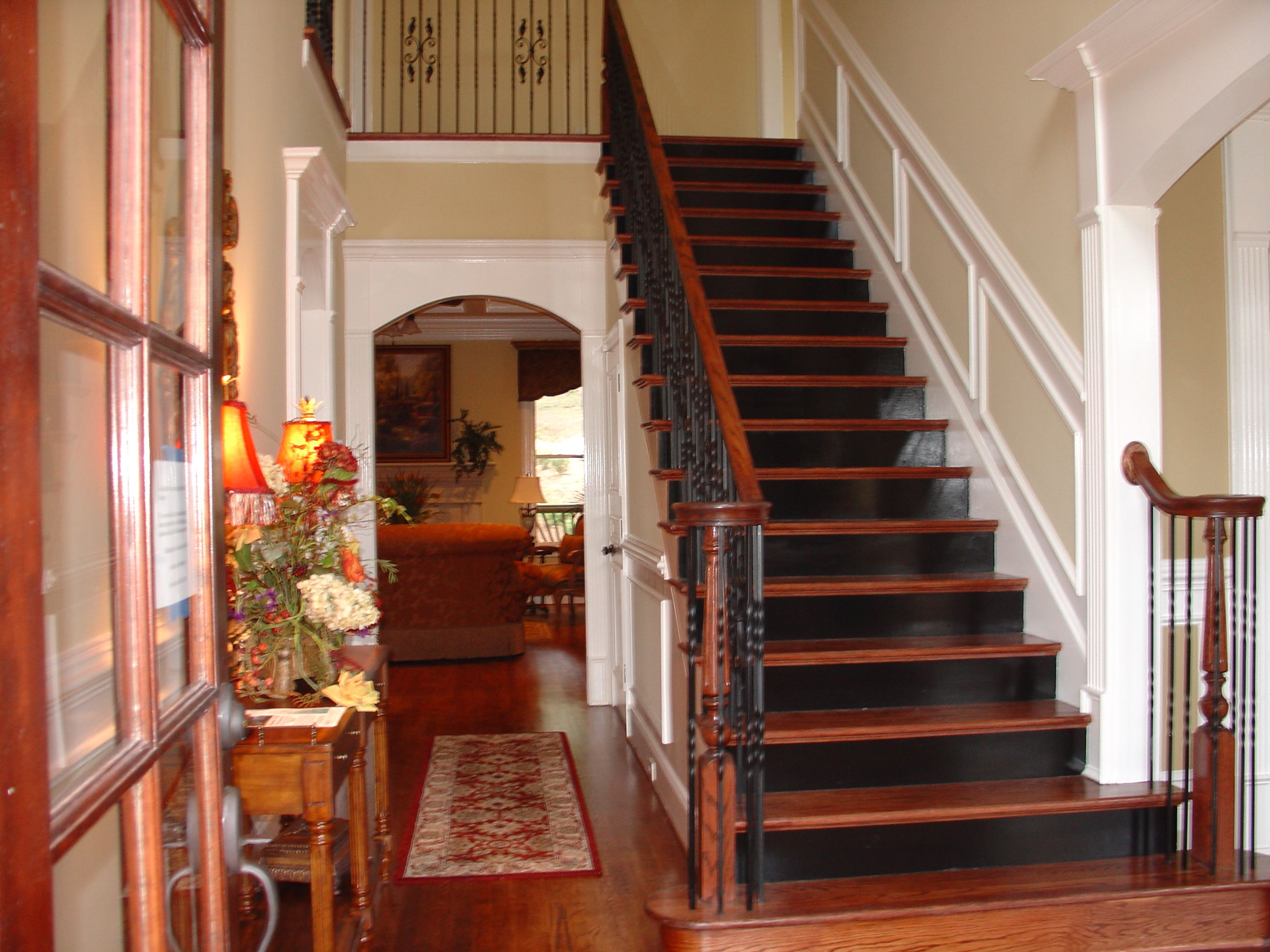 Foyer With Black Stair Risers.