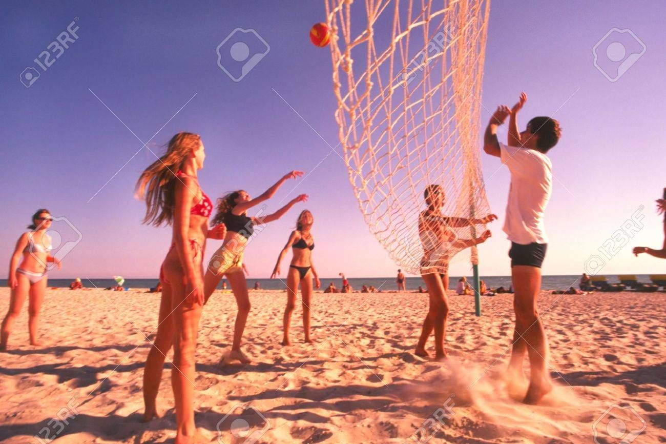 Young People Play Volleyball On Beach In Hot Sunny Day Stock Photo Ad Volleyball Beach Play Young In 2020 Olympic Games Olympic Badminton Beach Volleyball