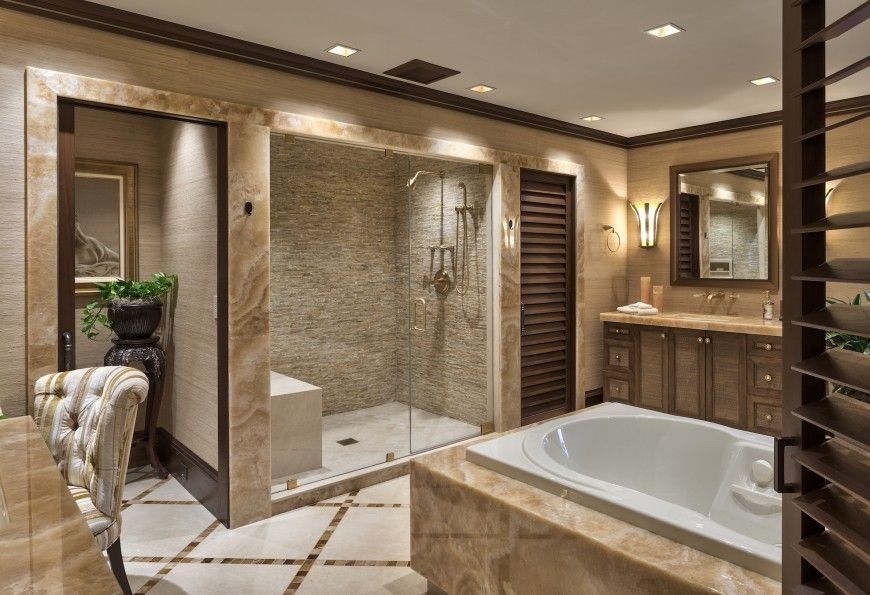 Gallery One This luxurious bathroom again features a Jacuzzi tub and a beautiful accent walled shower area