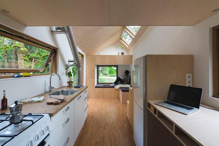 This tiny house built by carpenterDimka Wintzel, and designed byWalden Studiois 100% off grid, powered by solar panels, heated by a woodstove, and has a built in rainwater collection and filtrat…