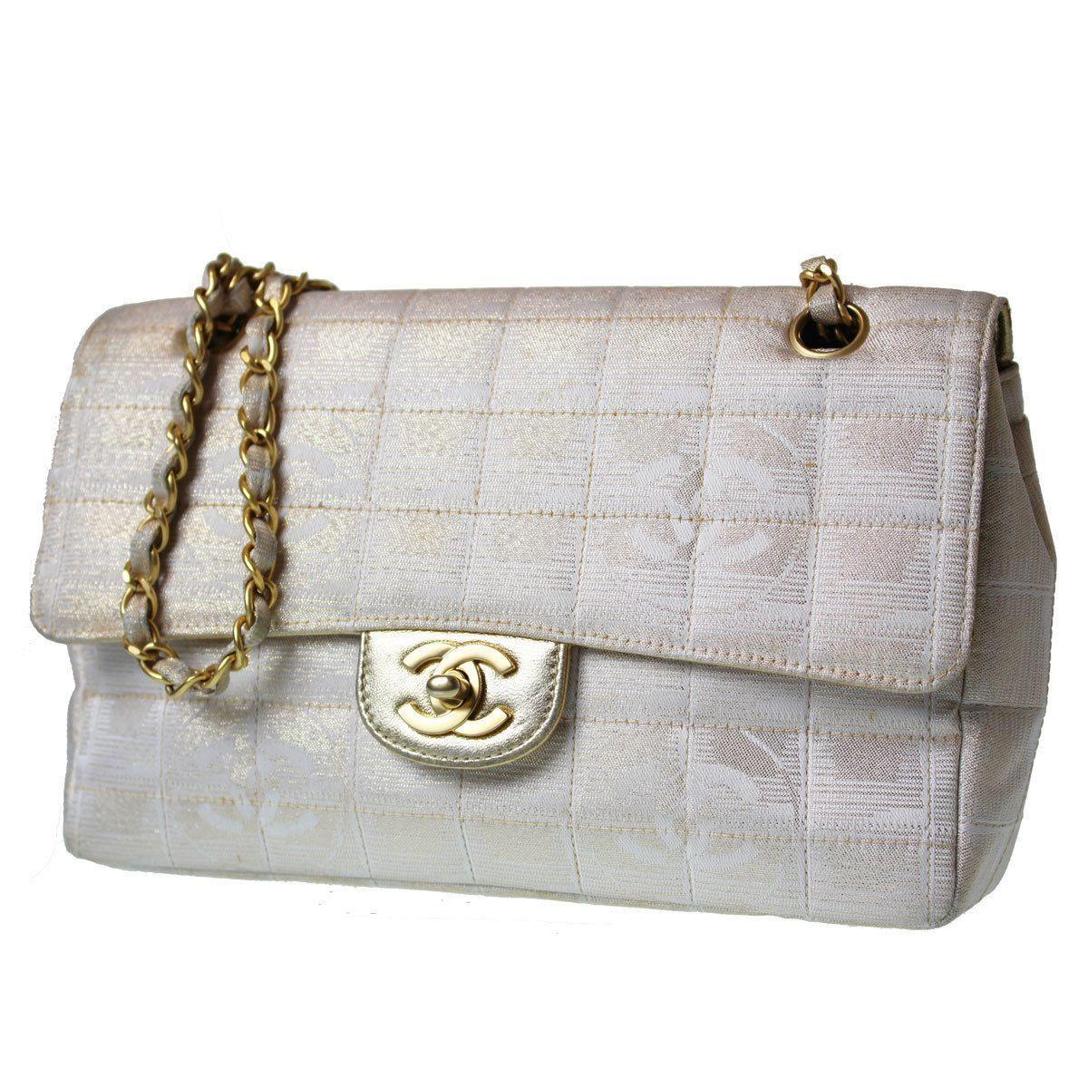 ce2293f04064db Vintage Authentic Chanel New Travel Line Chain Shoulder Gold Beige Canvas  Bag
