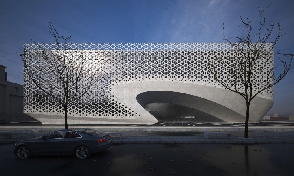 A beautiful perforated facade shields this office from India's harsh sun