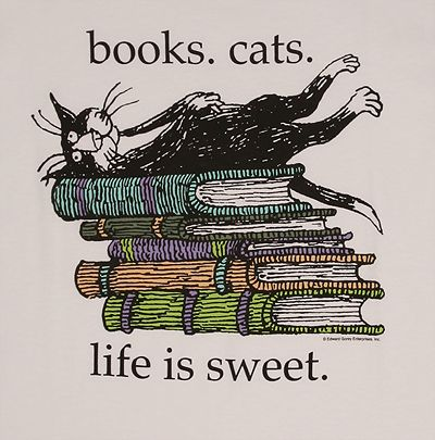 books and cats - a marriage made in heaven (except when the cat is sitting in the middle of the page you want to read) #Cats #Books