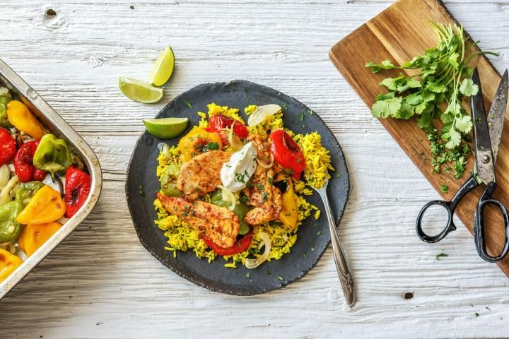 Fajita Chicken Tenders Over Yellow Rice with Charred Baby Bell Peppers