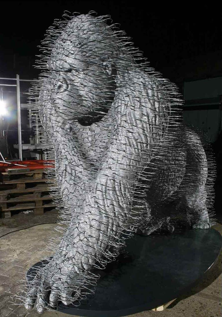 cool sculptures made of wire coat hangers, David Mach, Scottish artist