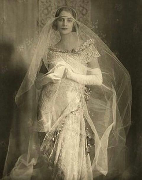 Bride in tulle and pearls circa 1921.