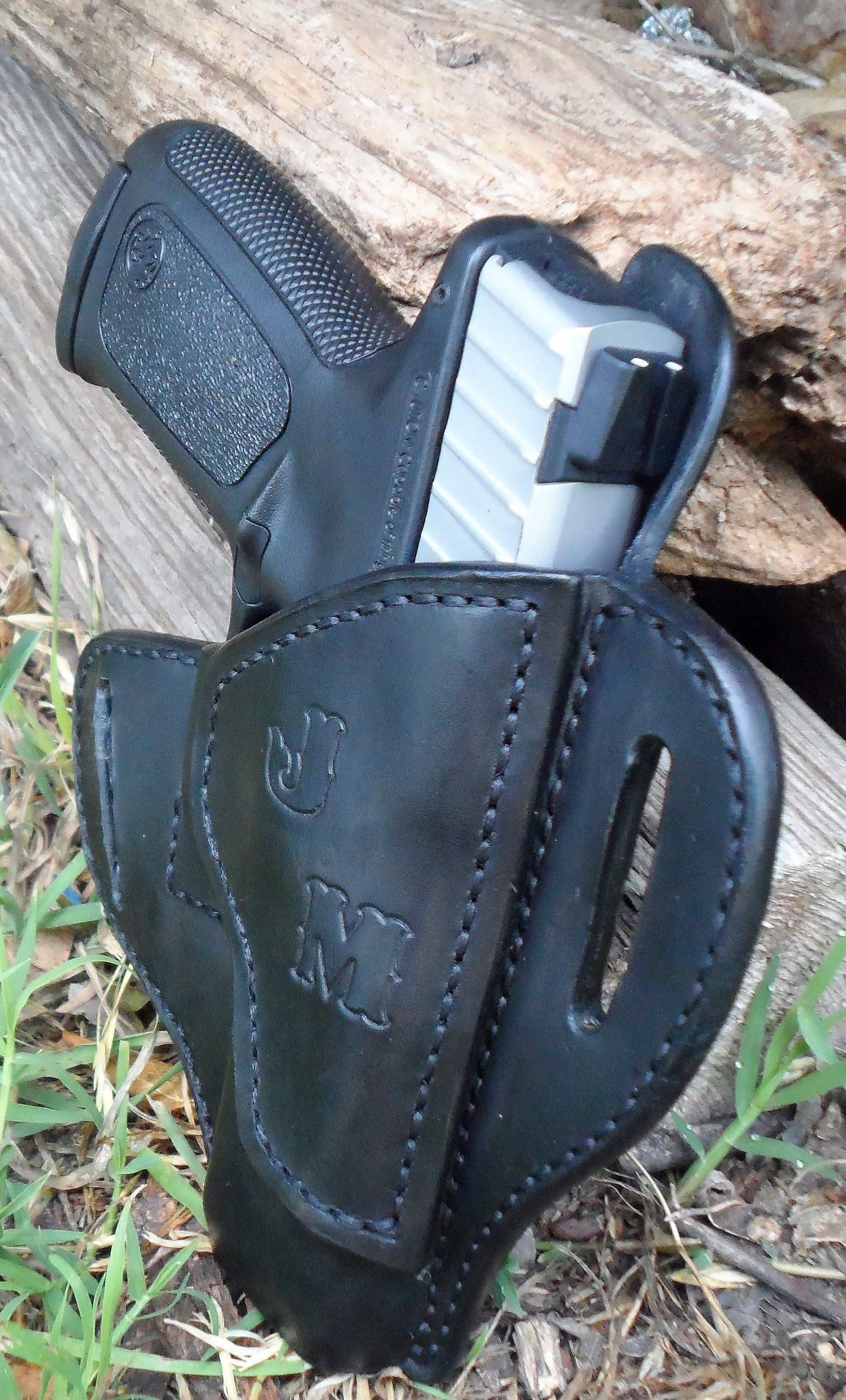 Smith & Wesson SDVE 9/40 cal saddle holster by AnchorsAwayLeather on