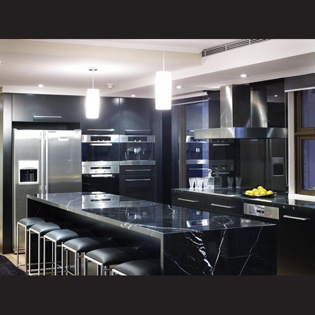 Small Kitchen With Reflective Surfaces: The Highly Reflective Surfaces In This Apartment Kitchen