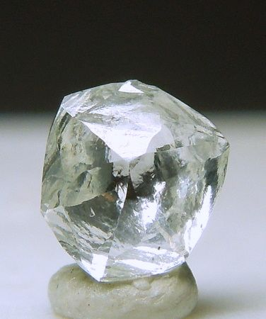 A lively colorless Diamond crystal with complex crystallization.  It has great clarity and lustrous faces. It weighs 0.24 carat and comes fr...