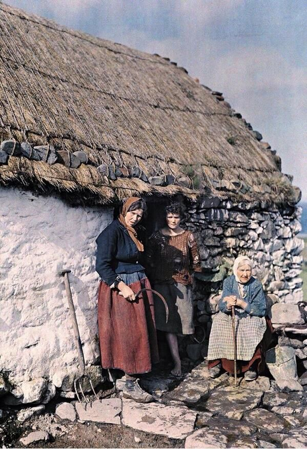 Three generations stand outside their stone cottage in Galway Ireland 1927 An early autochrome by Clifton R. Adams for National Geographic