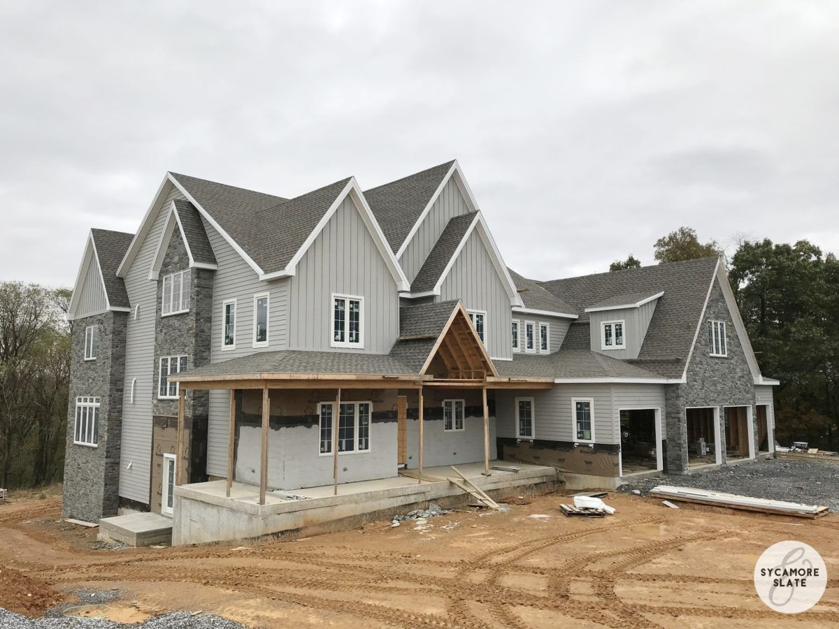 gray farmhouse with SW ellie gray siding and gray stone
