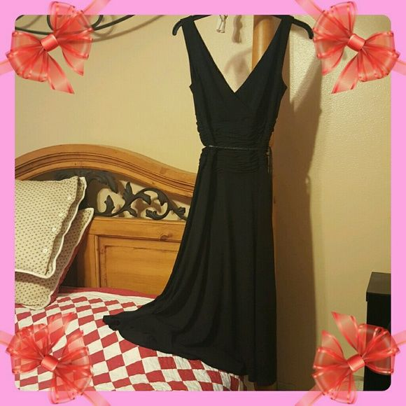 OPTIONS BY SHANI Black Long Prom Dress SZ 4 This dress is beautiful on, sleeveless with  V neck front & back, elastic scrunched look at the waist makes the dress flow smoothly when walking. Has a narrow black belt that ties with silver accents. Dress worn once to Prom by my nieces friend, they both looked gorgeous. You could wear the dress for a different ocassion as well. It's been cleaned. OPTIONS BY SHANI Dresses Prom