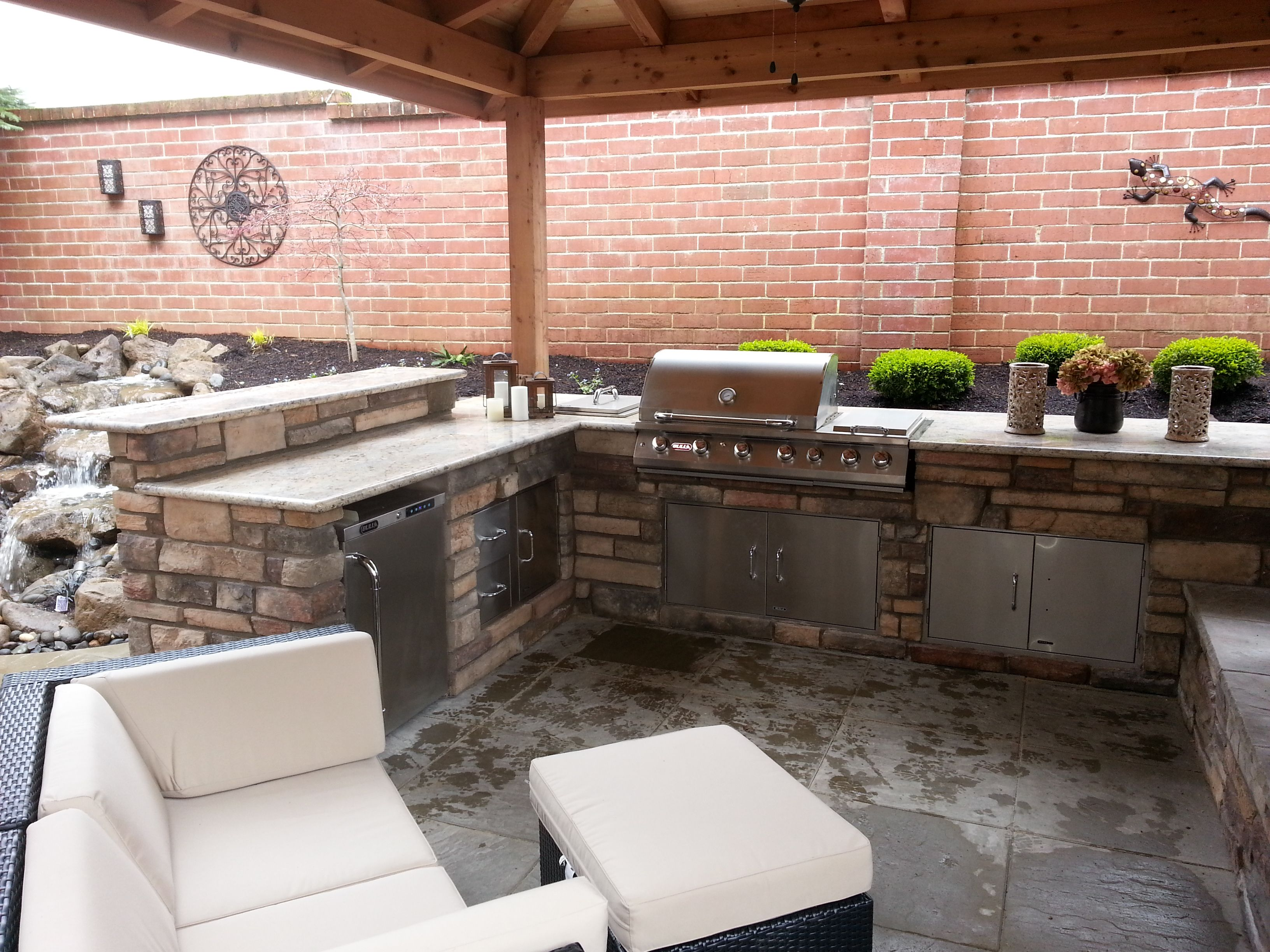 outdoor fireplace outdoor living outdoor kitchen covered patio