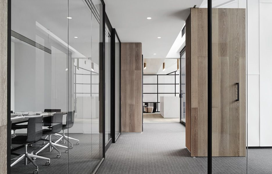 Love the glass partitions combined with the wood f in ish Opening glass walls