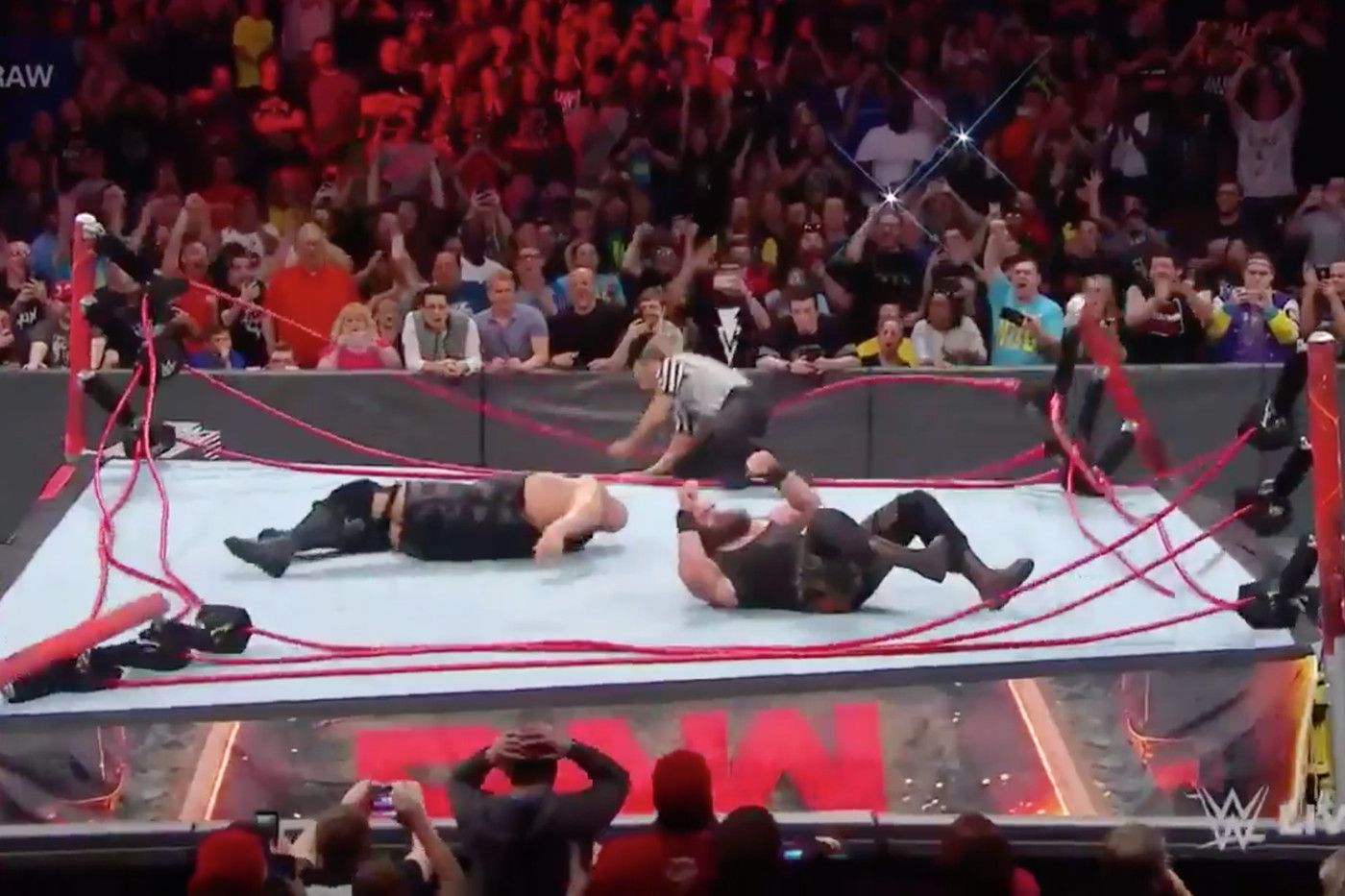 Wwe S Ring Collapsed When Two Wrestlers Went Falling From The Middle Rope Wwe Ring Rings Collapse