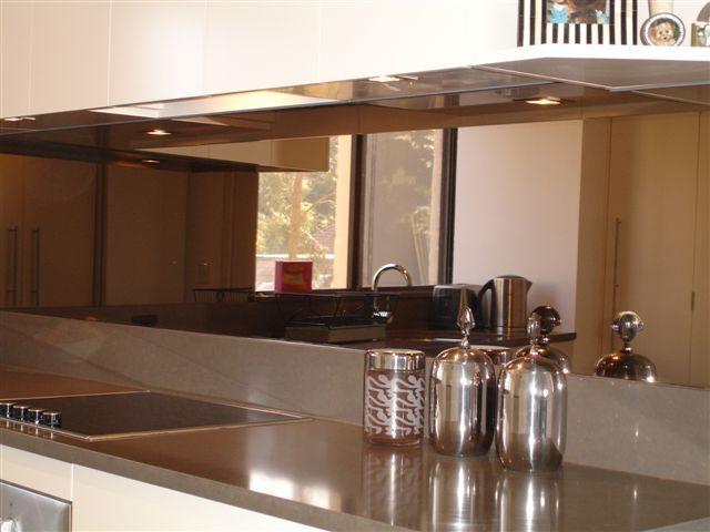 Bronze Tint Mirror Splashback Glass Shown By Artform Kitchen