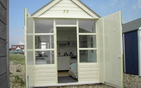 Britain still loves the beach hut beach huts beach hut for Beach hut designs