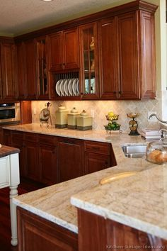 Kitchen Backsplash Cherry Cabinets White Counter cherry wood bottom cabinets and white top cabinets, white quartz