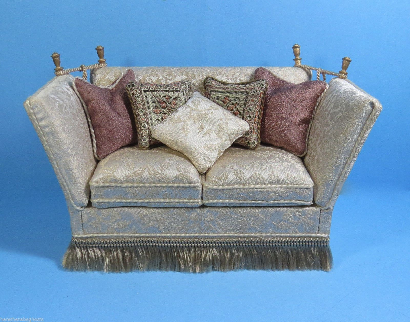 Ron Hubble Knowles sofa upholstered in cream damask with throw