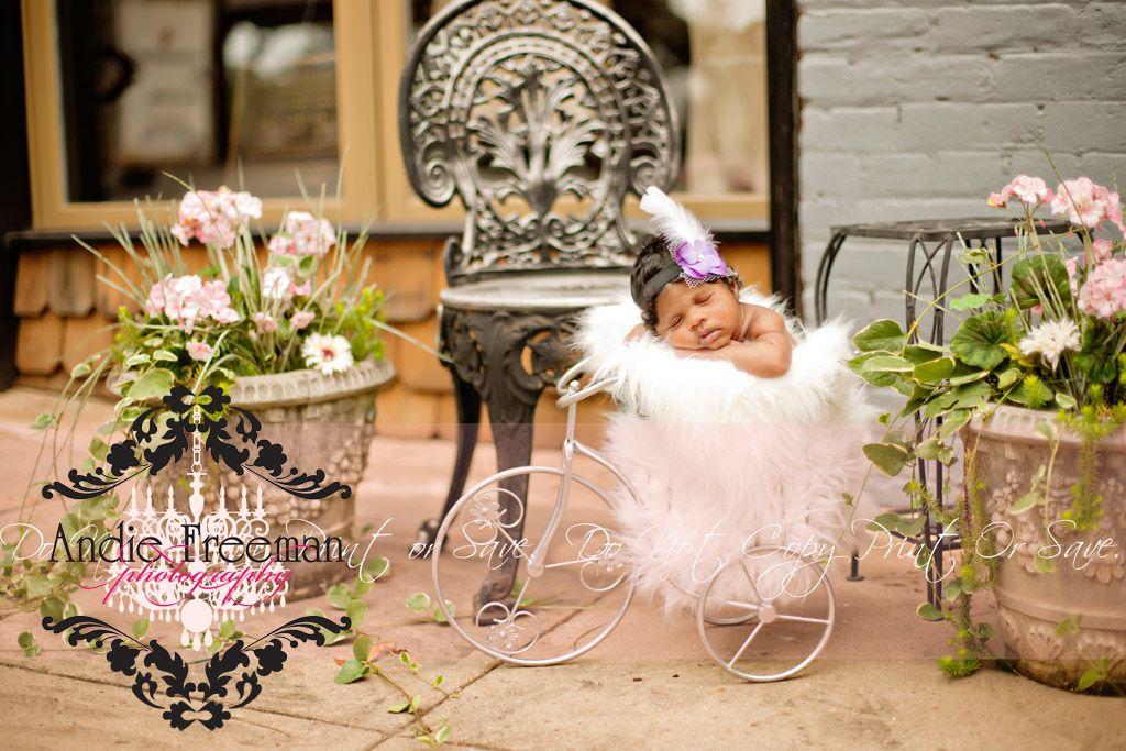 Newborn baby girl in tricycle.  Vintage newborn outdoor session.  www.TheAthensNewbornPhotographer.com