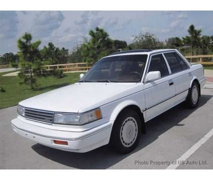 1987 Maxima SE Bought this when we lived in Orlando.  Beautiful car.