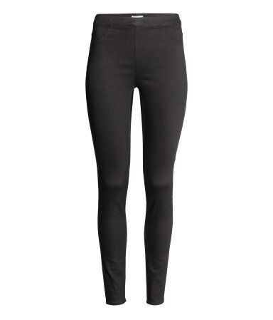 Treggings in superstretch twill with mock front pockets, regular back pockets, and an elasticized waistband.