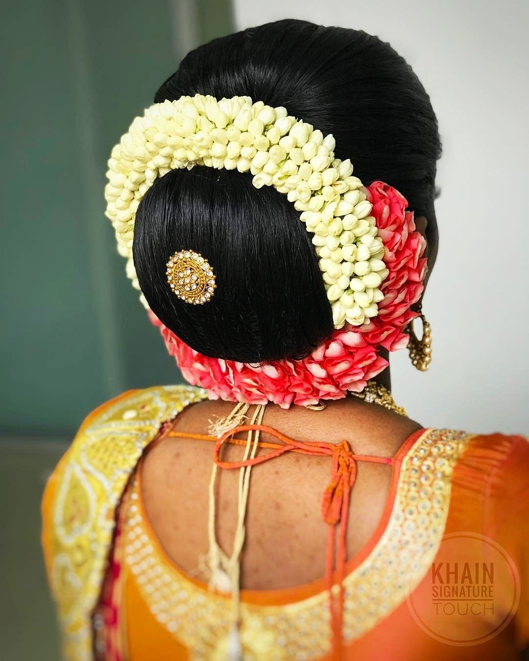 What a beautiful large low bun with real flower gajra ...