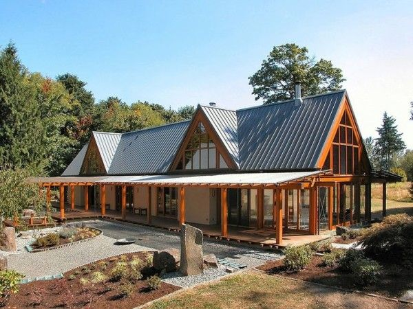 cabin house designs with rib steel roof panel on heat resistant rust proof paint above floor - Log Cabin Homes Designs
