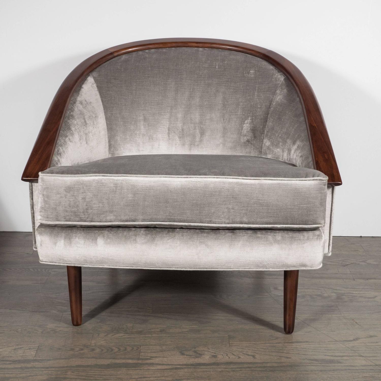Barrelback club chair with walnut trim and smoked