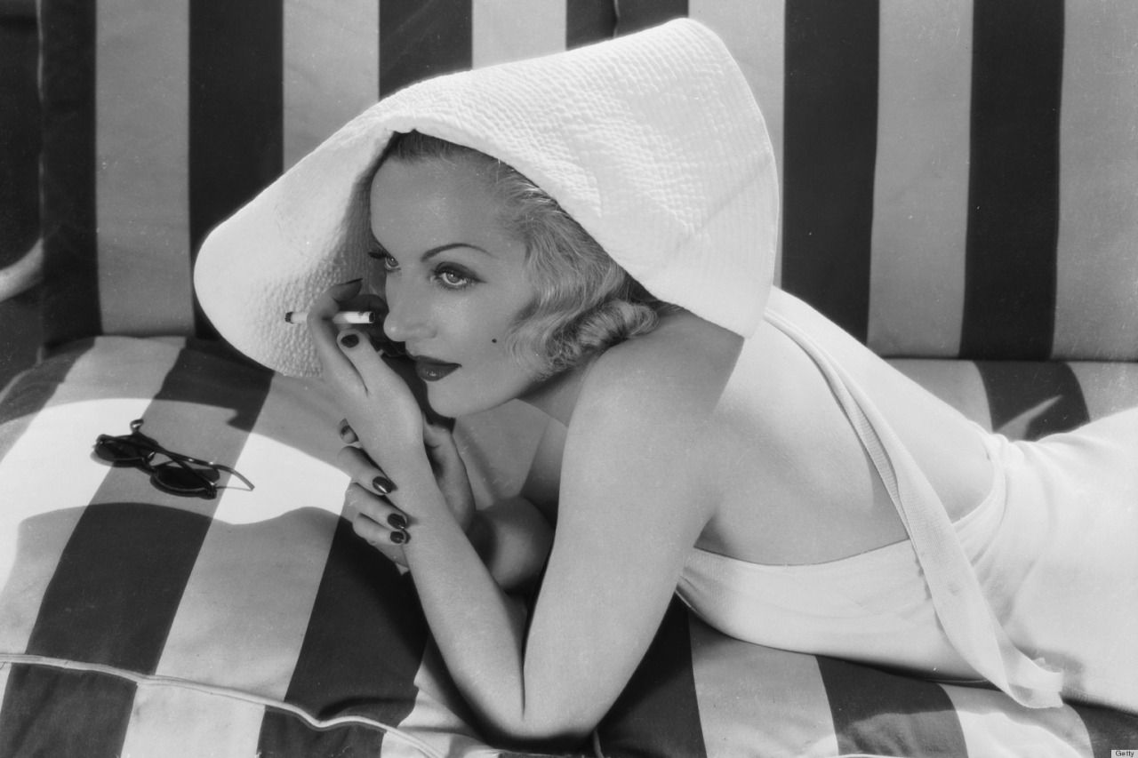 Carole Lombard modeling a bathing suit, 1934