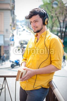 young man reading book and listening music $1
