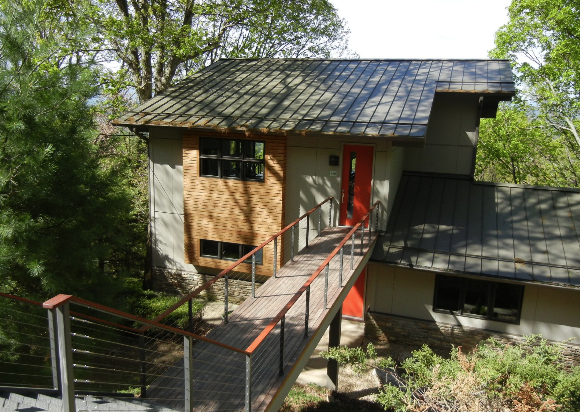 Retro Fit Design of Asheville added on to an existing ranch house in the Grove Park neighborhood to essentially create a new modern house. For more on modern homes and designers in the Asheville area go to www.modernasheville.com. #modern #home #asheville #jason #weil
