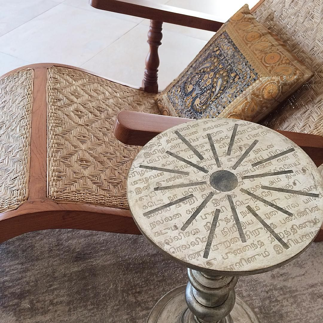 Greetings from India!! First task is cleaning because I haven't visited our place here for 18 months and it needs a freshening up to say the least. Then I relax here on this curvy lounge chair with a lime water and this little table I painted with a Tamil love poem written many centuries ago.