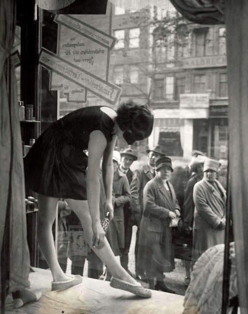 Live in-window advertising. Demonstration of slimming instrument, 1927.