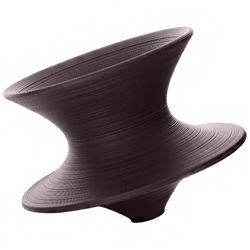 Spun, a rotating chair designed by Thomas Heatherwick, 2010, is a functional chair formed from a single profile rotated through 360 degrees, resulting in an innovative and dynamic twist on conventional furniture design.