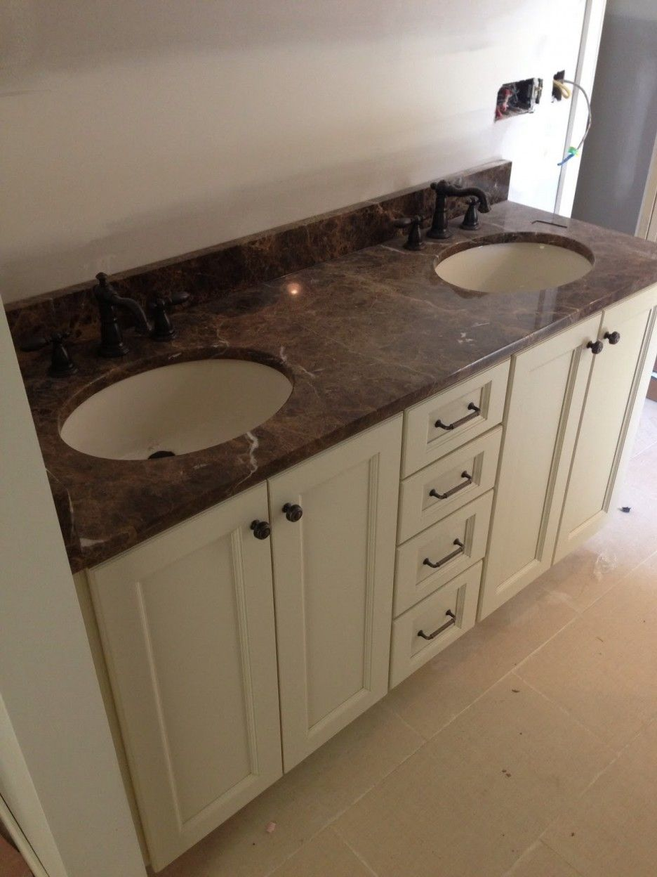 Brown Marble Countertop On White Vanity With Double Sink For