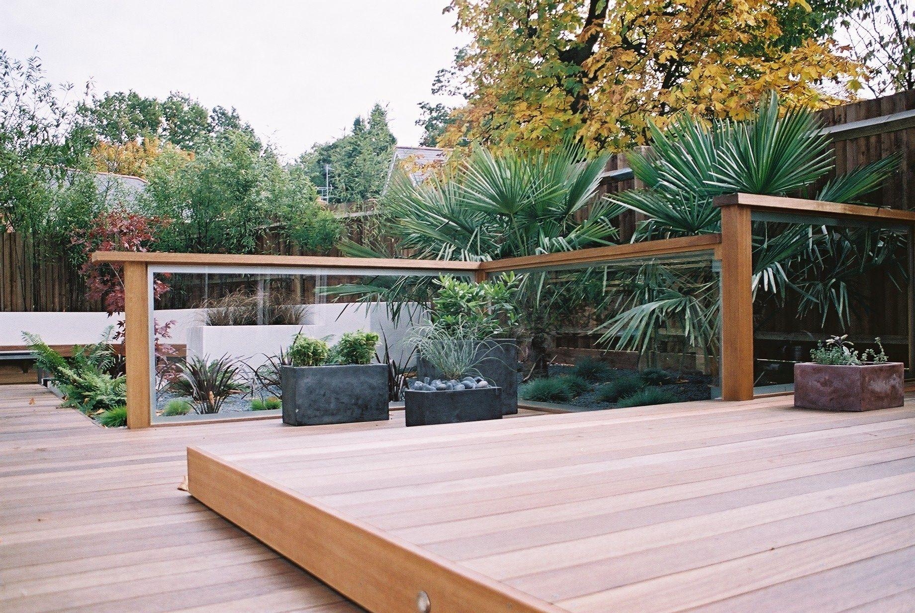 Split level deck with glass screens | Outdoor gardens ... on Split Level Backyard Ideas id=61434