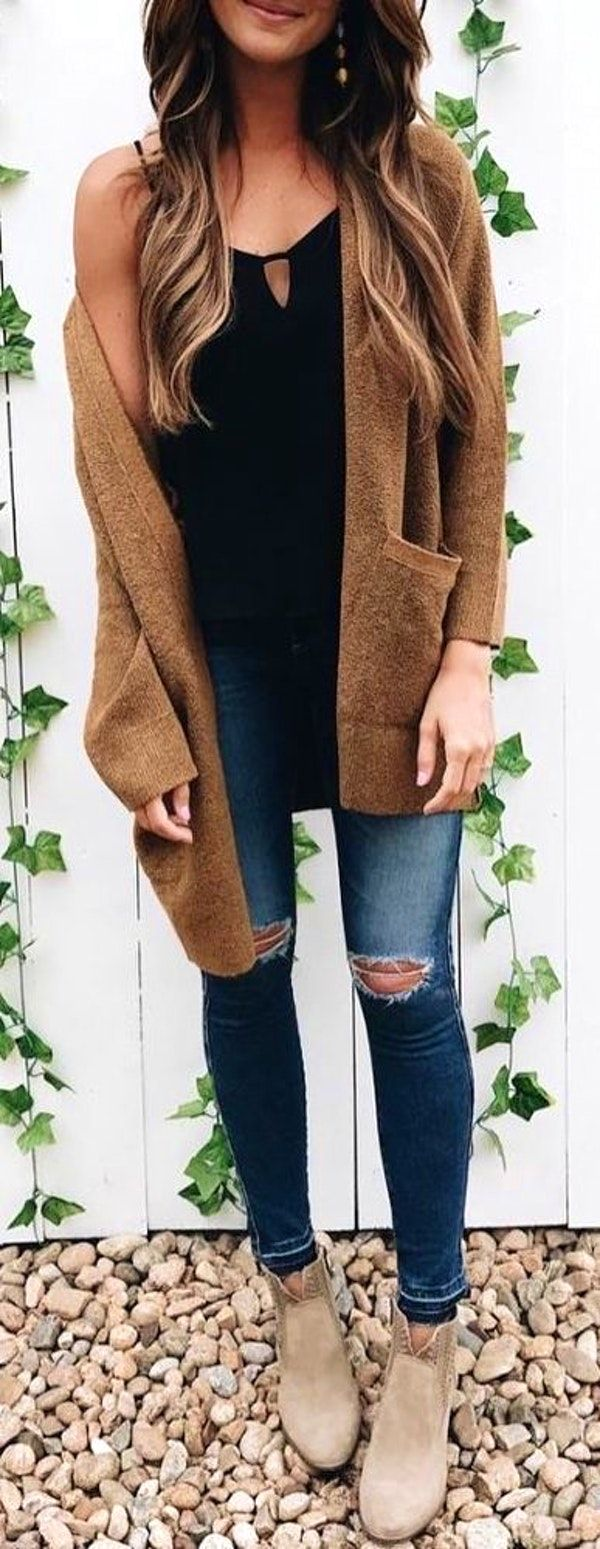 #winter #outfits brown cardigan, black spaghetti strap top, distressed blue jeans, and pair of beige booties outfit