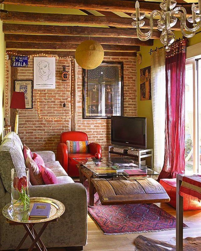Colorful eclectic living room with exposed brick walls @pattonmelo