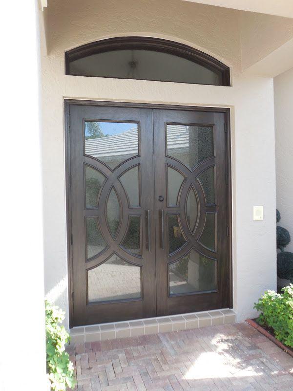 Custom double front doors with circle design. Mahogany ...