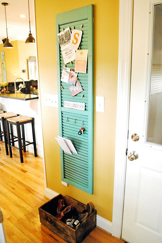 Keep outgoing mail, reminders and a place for shoes by the door, all the while blurring the line between indoors and outdoors with a brightly painted shutter hung on the wall.