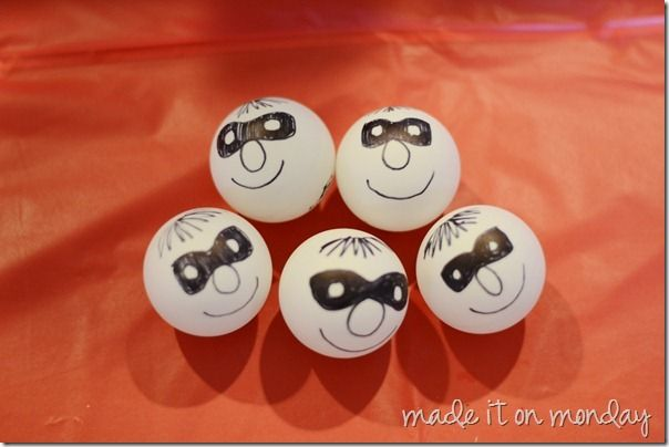 """""""During the party we played a Cops and Robbers game where the kids had to find the bad guys—ping pong balls with masked faces drawn on them. It was Easter Egg hunt style and the kids had a blast with it—especially since they noticed some of the hidden robbers when they arrived at the party."""""""
