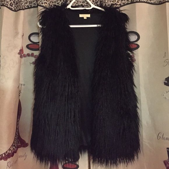 Faux fur vest How gorgeous is this faux fur vest! Best part, POCKETS!! Completely covered front to back in the fuax fur and lined with black satin material! I own too many so I decided someone else needs to enjoy this beautiful piece! Jackets & Coats Vests
