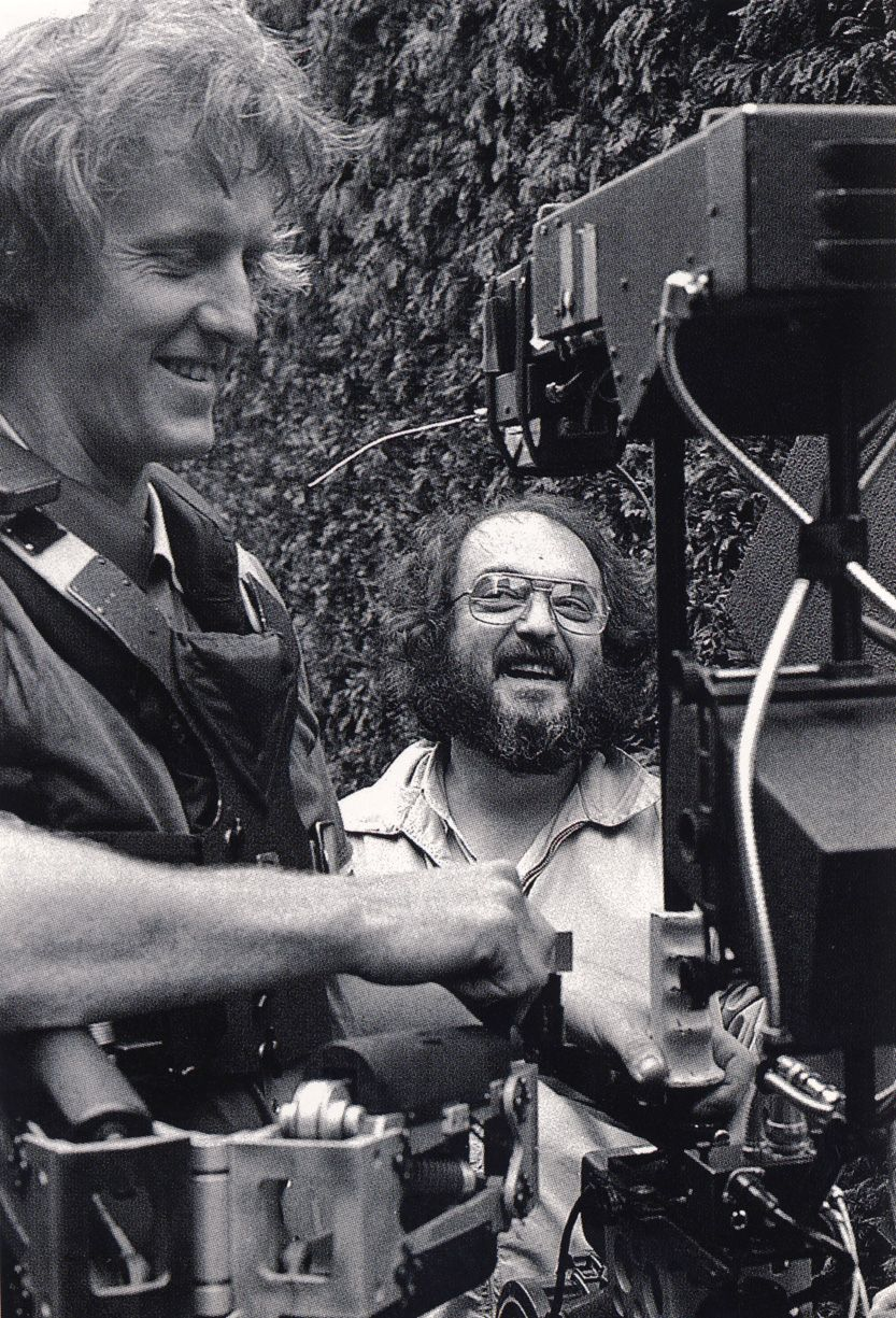 Stanley Kubrick, with a rare smile, works with Steadicam Operator Garrett Brown on the exterior Hedge Maze set of The Shining.