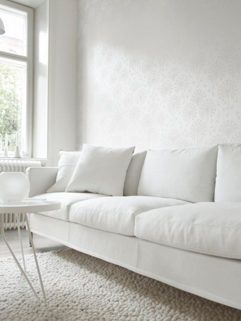 Beautiful All White Minimalist Living Room Interior With Tone On Tone Wallpaper Minimalist Sofa All White Room White Sofas