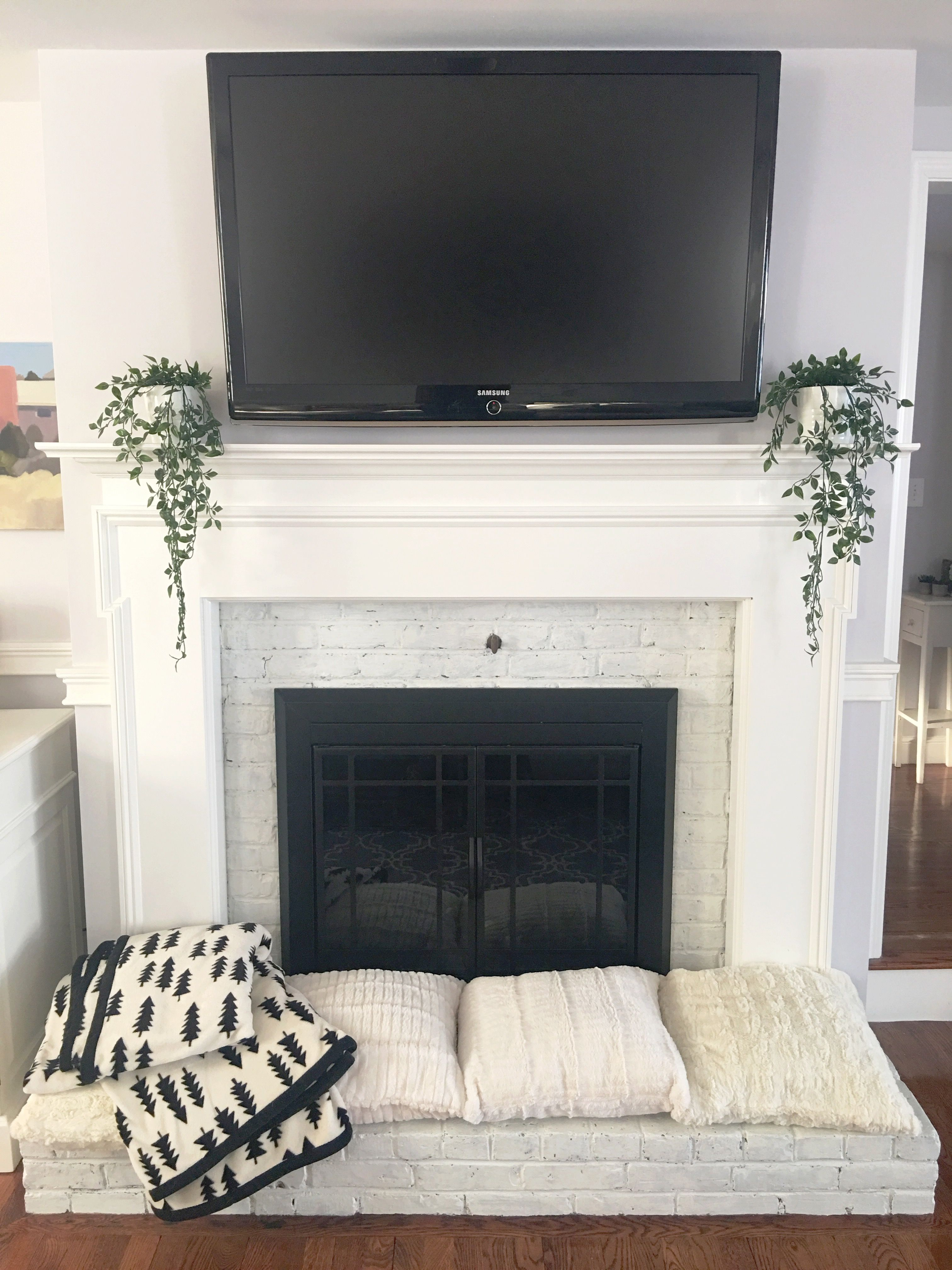 White painted brick fireplace, child-proof hearth, Ikea fejka potted ...