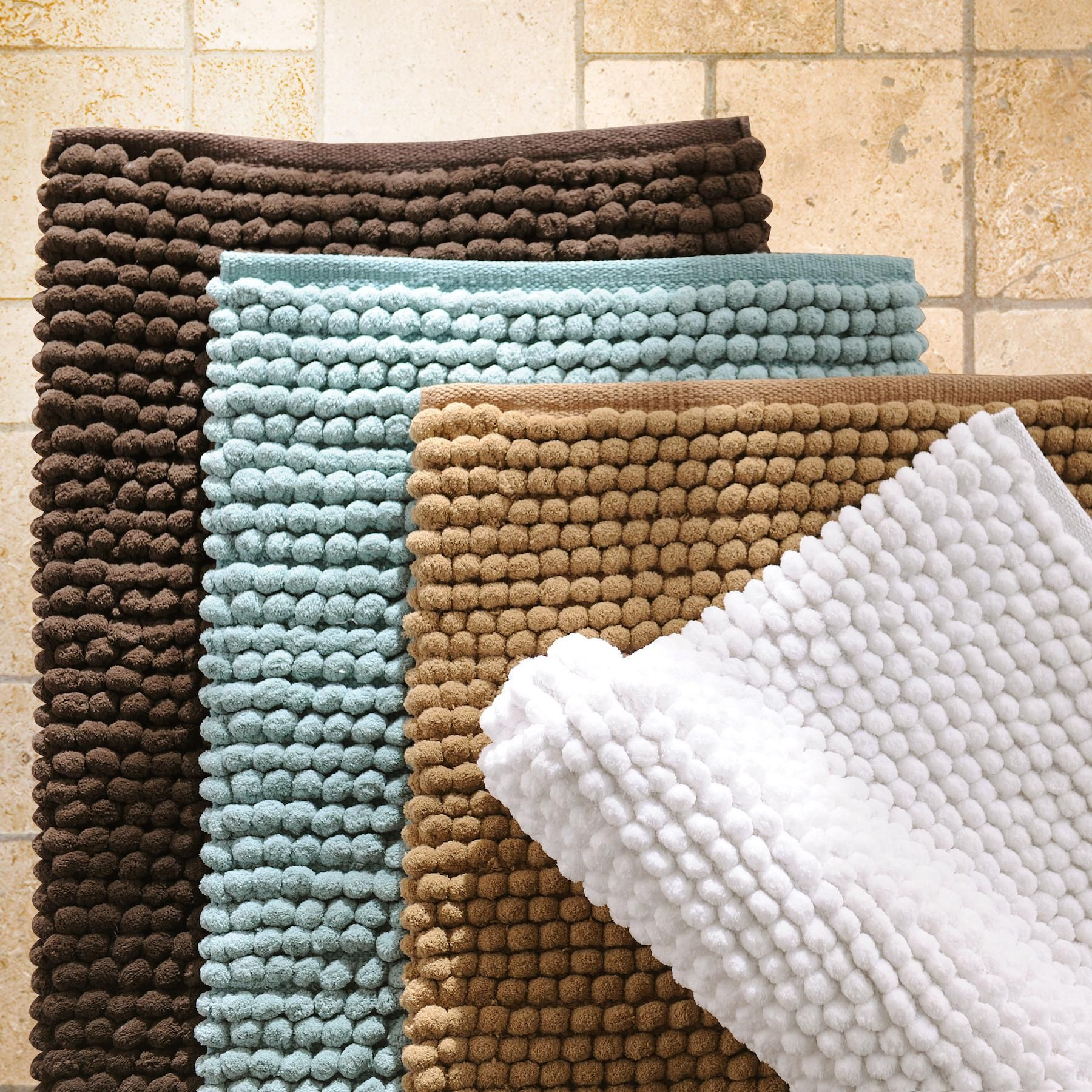 Step into comfort with our bathroom rugs! We have the